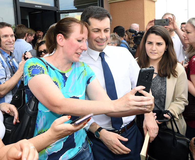 South Bend, Indiana Mayor Pete Buttigieg poses for photos with Erica Woolley of Nevada after Buttigieg spoke at a meet-and-greet at Madhouse Coffee on April 8, 2019 in Las Vegas, Nevada.