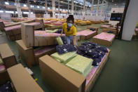 A worker prepares a 1,800-bed field hospital set up inside a cargo building in Don Mueang International Airport in Bangkok, Thailand, Thursday, July 29, 2021. Health authorities raced on Thursday to set up yet another large field hospital in Thailand's capital as the country recorded a new high in COVID-19 cases and deaths. The hospital, one of many already in use, was being set up at one of Bangkok's two international airports after the capital ran out of hospital beds for thousands of infected residents. (AP Photo/Sakchai Lalit)