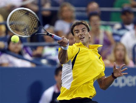 Tommy Robredo of Spain returns a forehand to Daniel Evans of Britain at the U.S. Open tennis championships in New York August 31, 2013. REUTERS/Eduardo Munoz