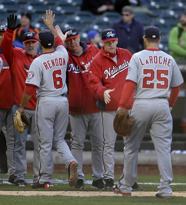 Washington Nationals manager Matt Williams, second from right, greets his team as they leave the field after the baseball game against the New York Mets at Citi Field in New York, Monday, March 31, 2014. The Nationals defeated the Mets 9-7. (AP Photo/Seth Wenig)