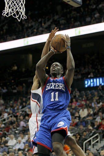 Philadelphia 76ers point guard Jrue Holiday (11) shoots over Atlanta Hawks point guard Jeff Teague (0) in second-half action of an NBA basketball game on Wednesday, March 6, 2013, in Atlanta. The Hawks won the game 107-96. (AP Photo/Todd Kirkland)