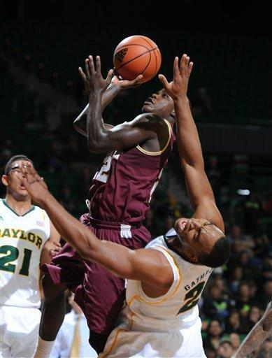 College of Charleston Anthony Stitt, top, attempts a shot over Baylor's Rico Gathers (2), right, in the first half of an NCAA college basketball game on Saturday, Nov. 24, 2012, in Waco, Texas. (AP Photo/Waco Tribune Herald, Rod Aydelotte)
