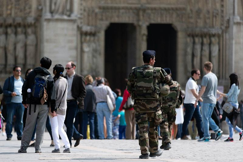 French soldiers patrol near the Notre-Dame cathedral in Paris on April 24, 2015 (AFP Photo/Kenzo Tribouillard)