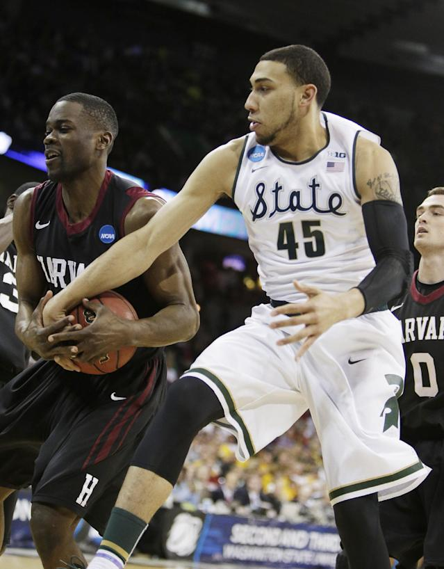 Michigan State's Denzel Valentine (45) and Harvard's Steve Moundou-Missi fight for a rebound in the first half during the third-round game of the NCAA men's college basketball tournament in Spokane, Wash., Saturday, March 22, 2014. (AP Photo/Young Kwak)