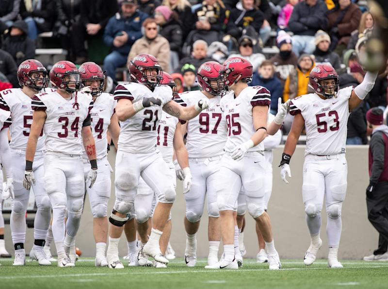 WEST POINT, NY - NOVEMBER 17: T.J. Holl #21, John Steffen #95, Alec Wisniewski #34, and Caleb Fell #53 of the Colgate Raiders pump up the fans during a game against the Army Black Knights at Michie Stadium on November 17, 2018 in West Point, New York. (Photo by Dustin Satloff/Getty Images)