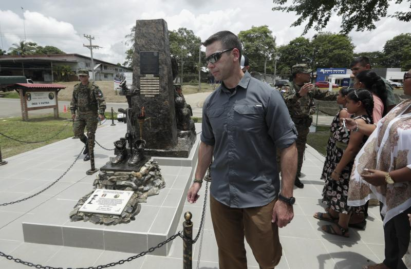Acting U.S. Homeland Security Secretary Kevin McAleenan, center, walks during a ceremony for police officers fallen in action, at the Panama Border Police headquarter in Meteti, Panama, Friday, Aug. 23, 2019. (AP Photo/Arnulfo Franco)