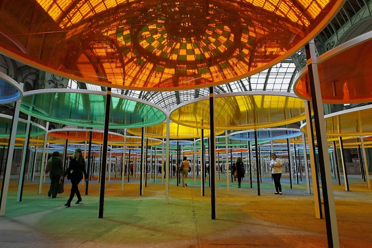 "View of the creation of contemporary artist Daniel Buren in the Grand Palais during the opening of ground-breaking Monumenta exhibit in Paris, Wednesday May 9, 2012. Monumenta, the hugely-popular annual installation project that's in its fifth year, dares an artist of international stature to ""move into"" the nave of one of the French capital's most monumental buildings, and own it. (AP Photo/Francois Mori)"