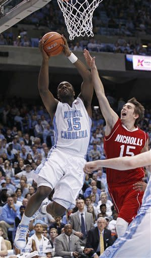 North Carolina's P.J. Hairston (15) drives to the basket as Nicholls State's Sam McBeath (15) defends during the second half of an NCAA college basketball game in Chapel Hill, N.C., Monday, Dec. 19, 2011. North Carolina won 99-49. (AP Photo/Gerry Broome)