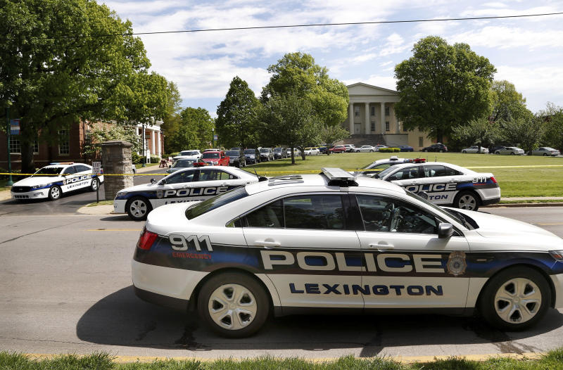 Police vehicles are parked near the scene of a stabbing on the Transylvania University campus in Lexington, Ky., Friday, April 28, 2017. A student was injured and another was arrested after a machete attack Friday morning at a Transylvania University coffee shop, according to Lexington police. (Charles Bertram/Lexington Herald-Leader via AP)