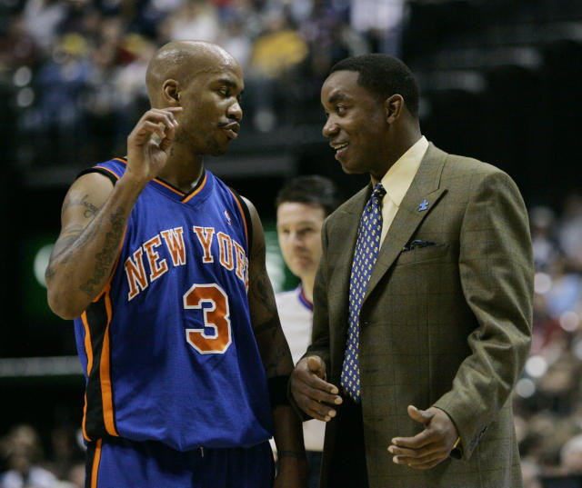 New York Knicks guard Stephon Marbury , left, talks with New York Knicks coach Isiah Thomas during the second quarter of an NBA basketball game against the Indiana Pacers in Indianapolis, Friday,Dec. 15, 2006. (AP Photo/Darron Cummings)