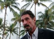 FILE PHOTO: Computer software pioneer McAfee speaks with reporters outside his hotel in Miami Beach