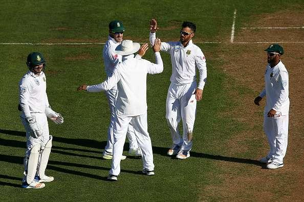 WELLINGTON, NEW ZEALAND - MARCH 16: JP Duminy of South Africa celebrates with teammates Faf du Plessis and Hashim Amla after taking the wicket of BJ Watling of New Zealand during day one of the Test match between New Zealand and South Africa at Basin Reserve on March 16, 2017 in Wellington, New Zealand. (Photo by Hagen Hopkins/Getty Images)