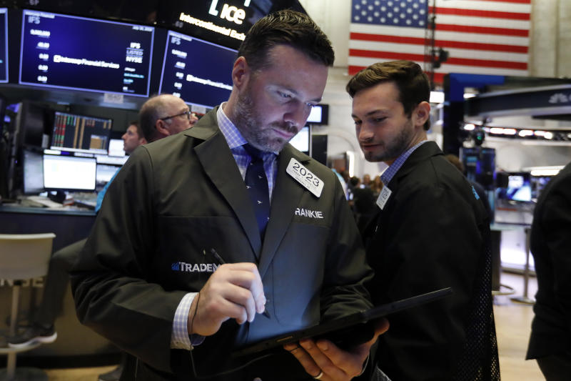 Traders Frank Masiello, left, and Joshua Trinker workon the floor of the New York Stock Exchange, Friday, July 19, 2019. U.S. stocks moved broadly higher in early trading on Wall Street Friday and chipped away at the week's losses. (AP Photo/Richard Drew)