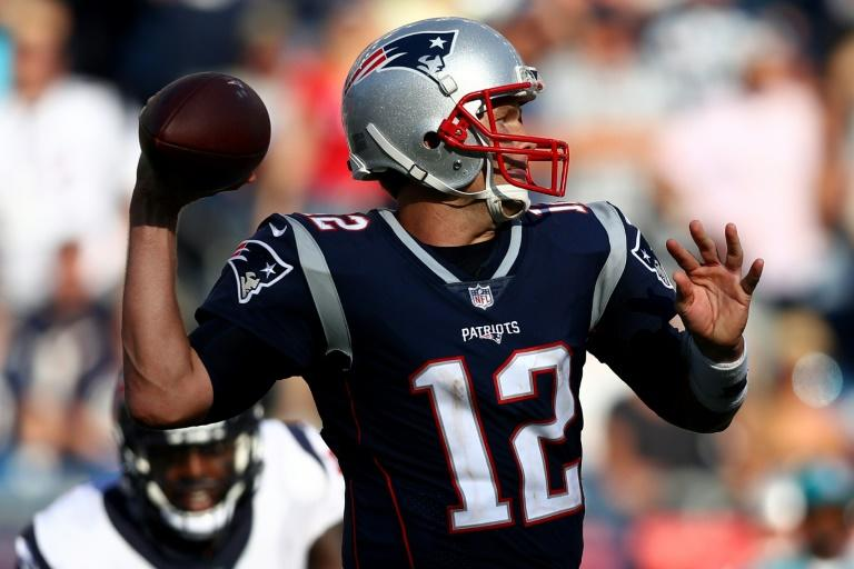 Tom Brady of the New England Patriots makes a pass against the Houston Texans, at Gillette Stadium in Foxboro, Massachusetts, on September 24, 2017