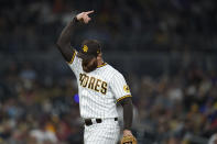 San Diego Padres relief pitcher Austin Adams reacts after getting the third out during the ninth inning of a baseball game against the Atlanta Braves, Friday, Sept. 24, 2021, in San Diego. (AP Photo/Gregory Bull)