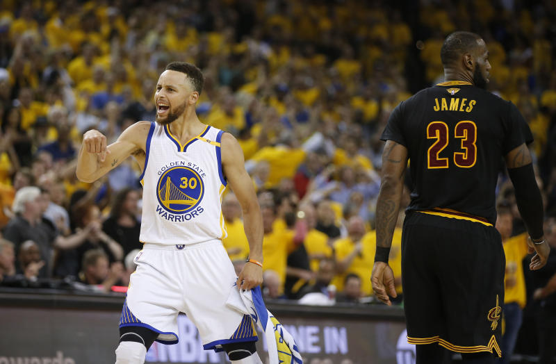 Stephen Curry, left, at the 2017 NBA Finals. (MediaNews Group/Bay Area News via Getty Images)