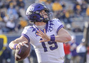 TCU quarterback Max Duggan (15) makes a pass against West Virginia during the second half of an NCAA college football game on Saturday, Nov. 14, 2020, in Morgantown, W.Va. (William Wotring/The Dominion-Post via AP)