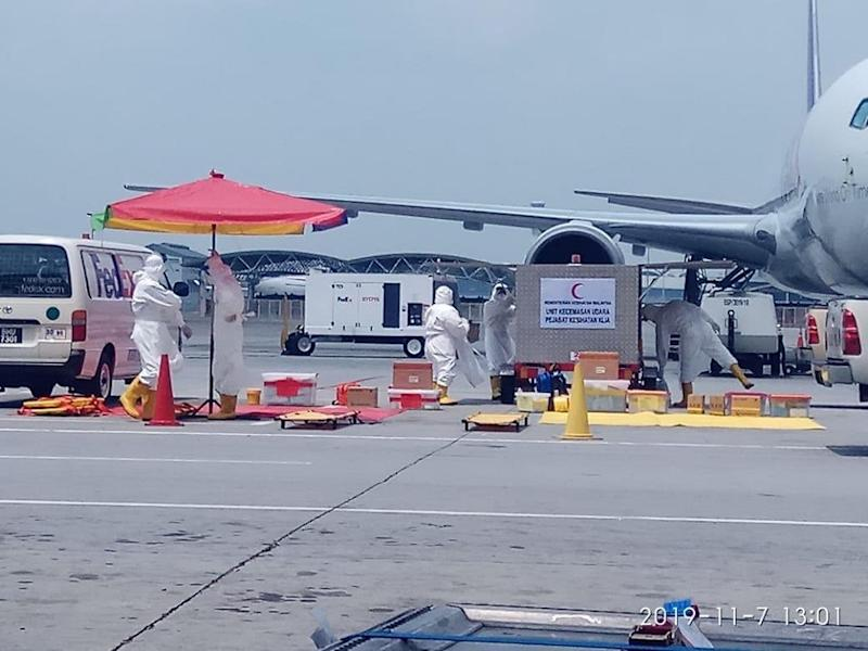 A team from the Fire and Rescue Department's Hazardous Materials Management Unit is pictured at the location. — Picture via Twitter/BernamaTV