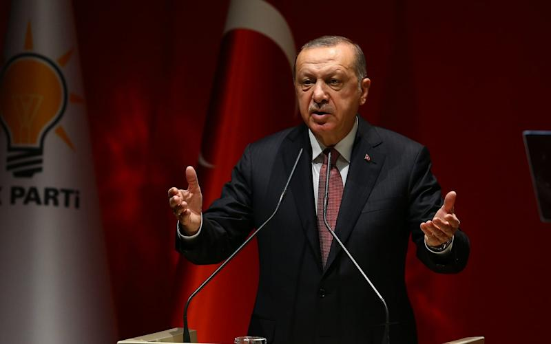 Turkey's President and ruling AK Party Chairman Recep Tayyip Erdogan delivers a speech - Anadolu