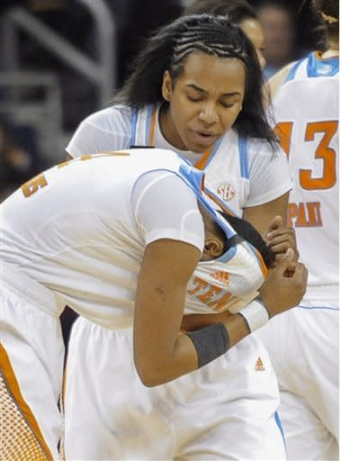 Tennessee guard Kamiko Williams buries her head as guard Ariel Massengale consoles her during the closing moments of an NCAA college basketball game in the Southeastern Conference women's tournament against against Texas A&M, Saturday, March 9, 2013, in Duluth, Ga. Texas A&M won 66-62. (AP Photo/John Amis)