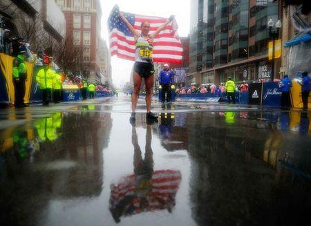 Desiree Linden of the U.S. celebrates after winning the women's division of the 122nd Boston Marathon in Boston, Massachusetts, U.S., April 16, 2018. REUTERS/Brian Snyder