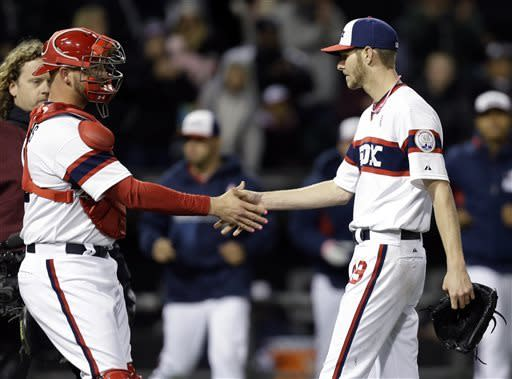 Chicago White Sox starter Chris Sale, right, celebrates with catcher Tyler Flowers after the White Sox defeated the Los Angeles Angels 3-0 in a baseball game in Chicago, Sunday, May 12, 2013. (AP Photo/Nam Y. Huh)