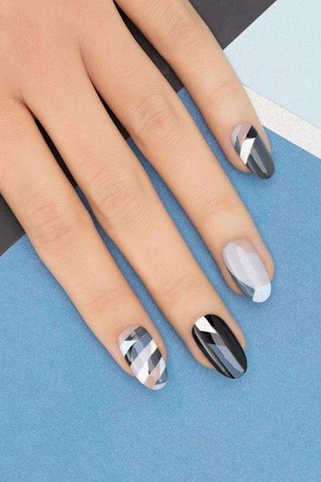 """<p>When you let negative space pop through these white, black, and grey patterns, this look  feels classic  -  not harsh.</p><p><strong>See more at <a rel=""""nofollow"""" href=""""https://www.instagram.com/misspopnails/"""">Miss Pop Nails</a>.</strong></p>"""