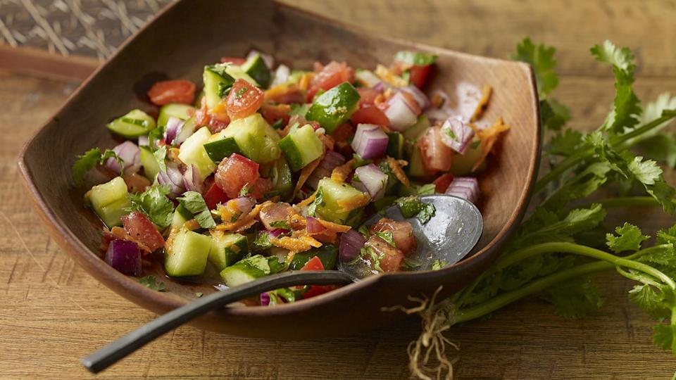 """<p>Cucumber, tomatoes and carrots are crunchy, colorful vegetables, but they're not exactly known for being packed with flavor. This salad remedies that issue with a vibrant dressing made of lime, honey and red onion.</p> <p><a href=""""https://www.thedailymeal.com/recipes/east-african-fresh-tomato-and-cucumber-salad-recipe?referrer=yahoo&category=beauty_food&include_utm=1&utm_medium=referral&utm_source=yahoo&utm_campaign=feed"""" rel=""""nofollow noopener"""" target=""""_blank"""" data-ylk=""""slk:For the Fresh Tomato and Cucumber Salad recipe, click here."""" class=""""link rapid-noclick-resp"""">For the Fresh Tomato and Cucumber Salad recipe, click here.</a></p>"""