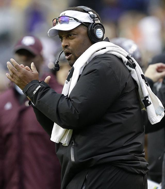 Texas A&M head coach Kevin Sumlin calls out from the sideline in the first half of an NCAA college football game against LSU in Baton Rouge, La., Saturday, Nov. 23, 2013. (AP Photo/Gerald Herbert)