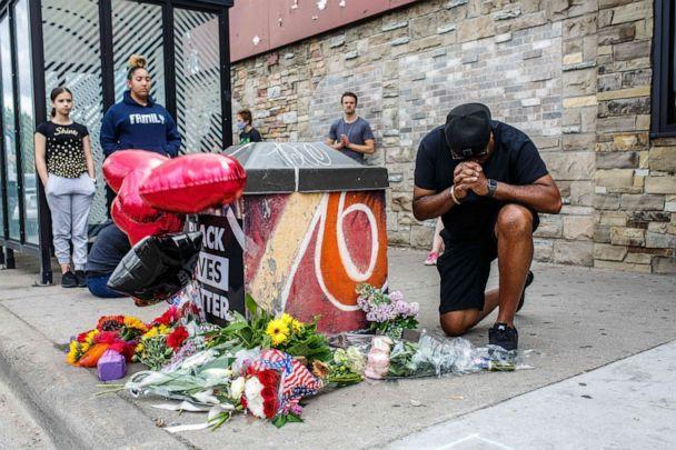 PHOTO: A protester prays in front of the memorial of George Floyd who died in custody on May 26, 2020 in Minneapolis. (AFP via Getty Images, FILE)