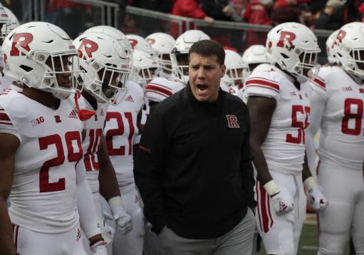 Rutgers head coach Chris Ash leads his team onto the field before an NCAA college football game against WisconsinSaturday, Nov. 3, 2018, in Madison, Wis. (AP Photo/Morry Gash)