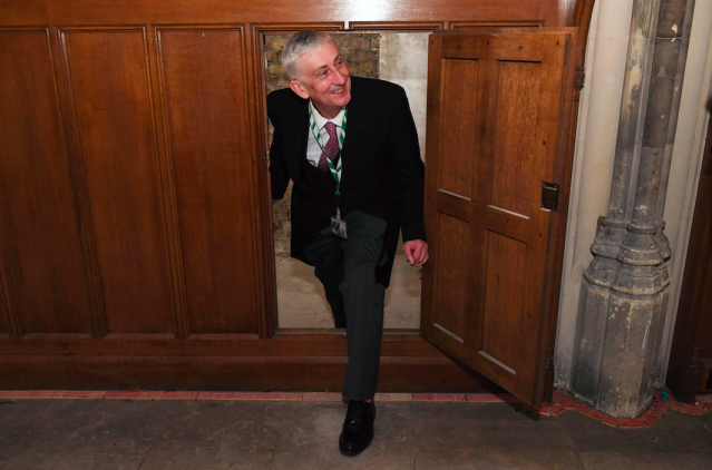 Lindsay Hoyle, Speaker of the House of Commons, being shown a secret doorway that has been rediscovered in the building. (PA)