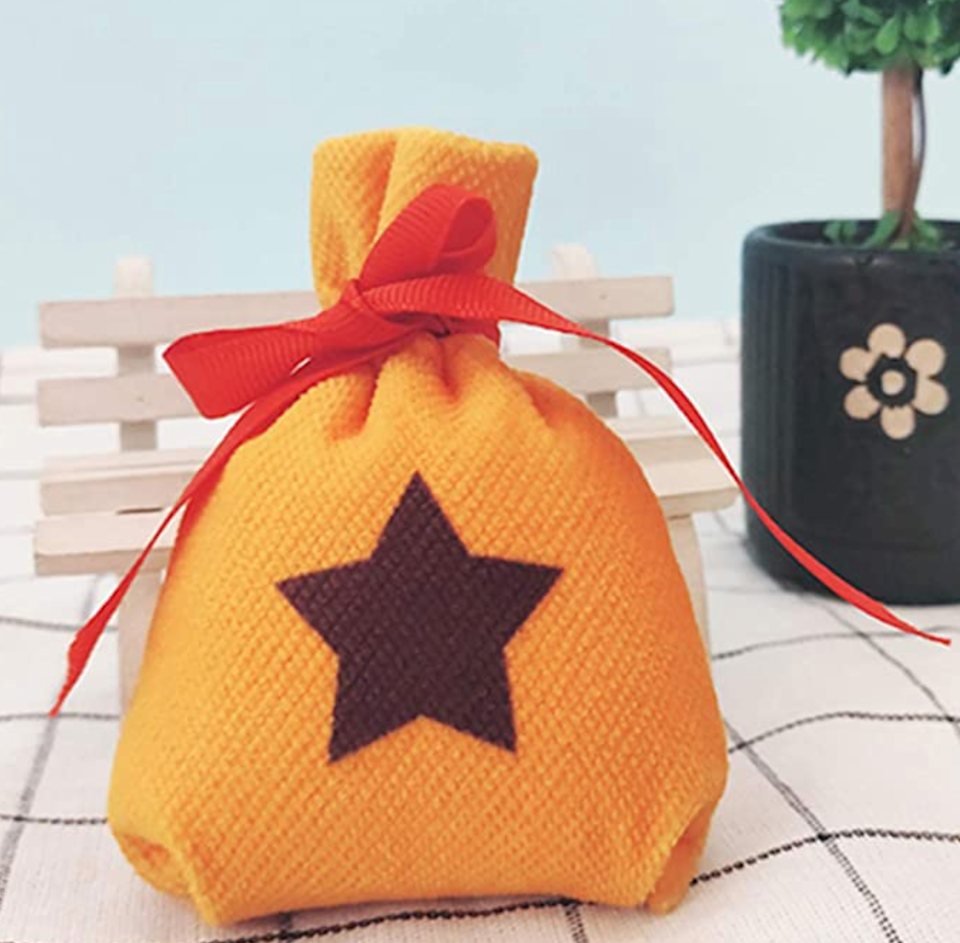 """<h2>Bell Bag<br></h2><br>The bell bag is an Animal Crossing essential inside the game — so, why not make it an essential for your IRL costume?<br><br><em>Shop</em> <strong><em><a href=""""https://www.amazon.com/stores/YuDanae/page/66D09DEF-FBE8-40C1-B673-41254CC2B71B"""" rel=""""nofollow noopener"""" target=""""_blank"""" data-ylk=""""slk:YuDanae"""" class=""""link rapid-noclick-resp"""">YuDanae</a></em></strong> <br><br><strong>YuDanae</strong> Mini Bell Bag, $, available at <a href=""""https://amzn.to/2Geg3cS"""" rel=""""nofollow noopener"""" target=""""_blank"""" data-ylk=""""slk:Amazon"""" class=""""link rapid-noclick-resp"""">Amazon</a>"""