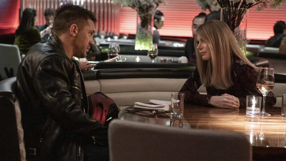 """This image released by Sony Pictures shows Tom Hardy, left, and Michelle Williams in a scene from """"Venom: Let There Be Carnage."""" (Jay Maidment/Sony Pictures Entertainment via AP)"""