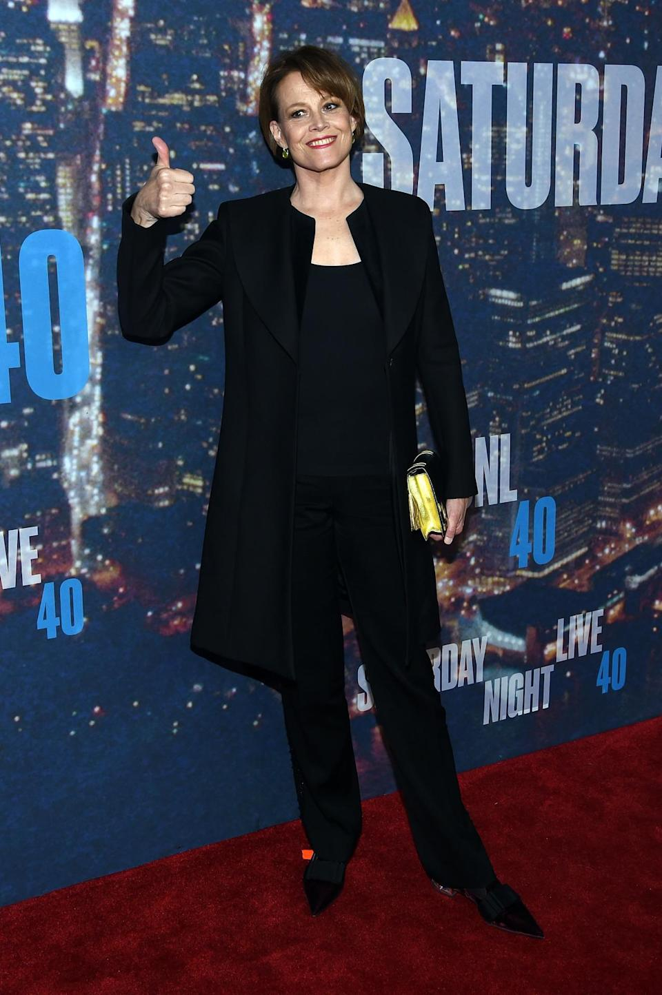 Sigourney Weaver plays it safe in head-to-toe black separates.