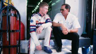 Dale Earnhardt Jr. and father Dale Earnhardt talk during the 1998 Coca-Cola 600. (Photo by Sporting News via Getty Images via Getty Images)