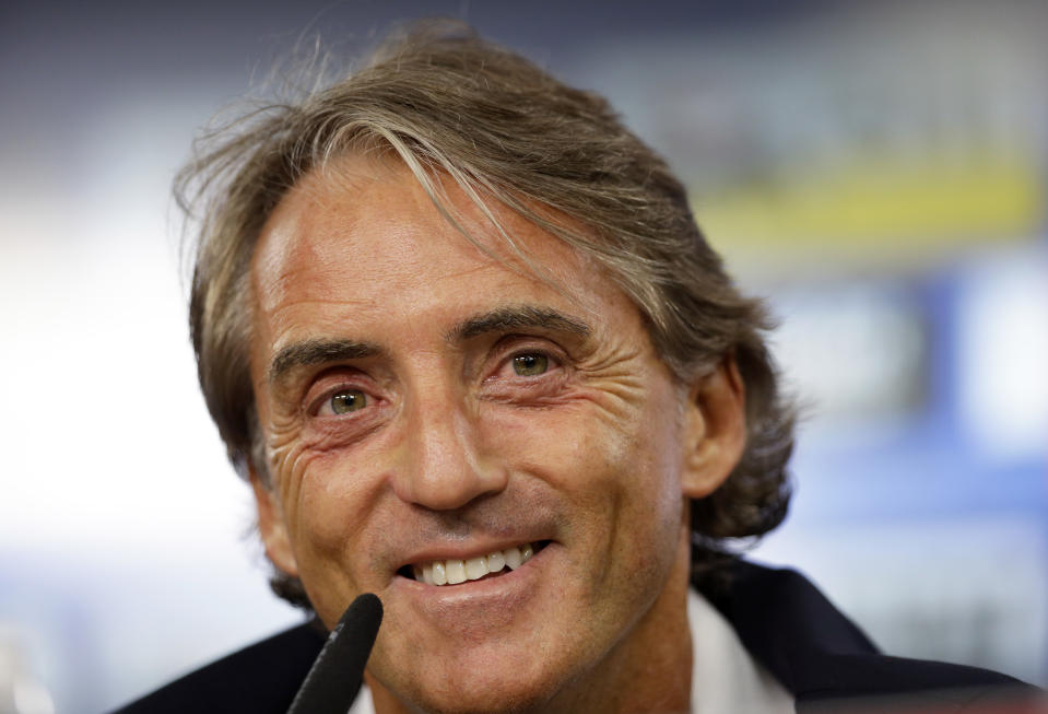 Italy coach Roberto Mancini smiles during a news conference at the Luz stadium in Lisbon, Sunday, Sept. 9, 2018. Italy will play Portugal Monday in a UEFA Nations League soccer match. (AP Photo/Armando Franca)