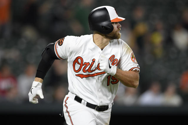 Baltimore Orioles' Chris Davis runs toward first as he lined out during the fifth inning of a baseball game against the Oakland Athletics, Monday, April 8, 2019, in Baltimore. (AP Photo/Nick Wass)
