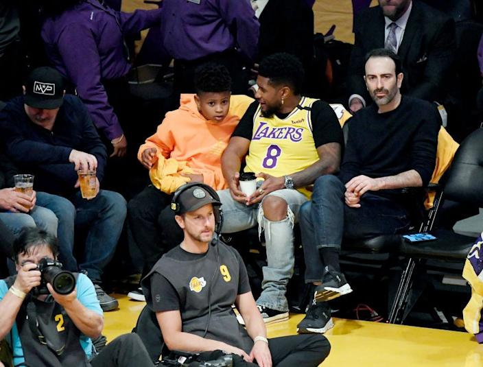 Usher and one of his two sons attend the Los Angeles Lakers and the Portland Trail Blazers game at Staples Center on January 31, 2020 in Los Angeles, California. (Photo by Kevork Djansezian/Getty Images)