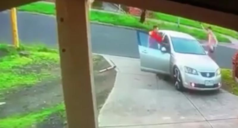 Two men are pictured fighting back against two alleged intruders trying to make a getaway in a car.