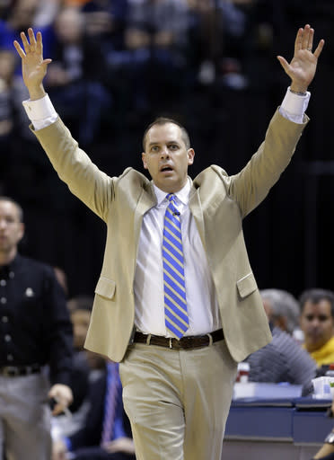 Indiana Pacers head coach Frank Vogel complains about a call in the second half of an NBA basketball game against the Oklahoma City Thunder in Indianapolis, Sunday, April 13, 2014. (AP Photo/Michael Conroy)