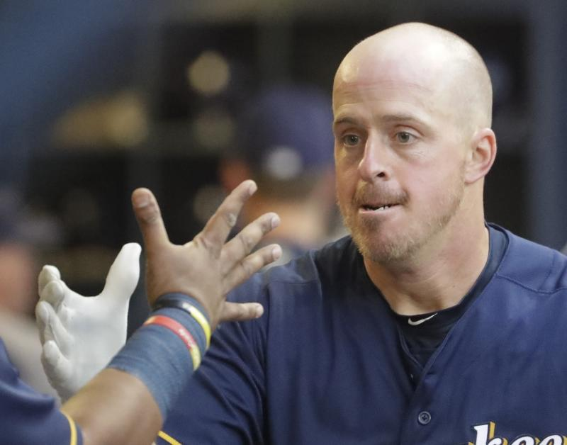 Milwaukee Brewers catcher Erik Kratz is playing for his sixth team in four seasons. He told the Yahoo Sports MLB podcast what it's like to be a big-league journeyman. (AP Photo/Morry Gash)