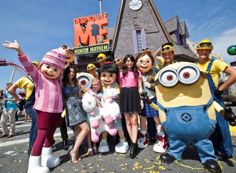 """This image released by Universal Orlando shows actresses with the characters they voiced from the animated film """"Despicable Me,"""" from left, Dana Gaier with the character Edith, Elsie Fisher with Agnes and Miranda Cosgrove, who voiced Margo, at the grand opening of the 3-D ride """"Despicable Me Minion Mayhem,""""  based on the animated film, Monday, July 2, 2012 in Orlando, Fla. (AP Photo/Universal Orlando)"""