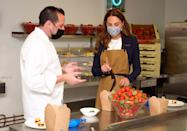 <p>The Duchess of Cambridge Kate talked with chef Adam Fargin and prepared strawberries in the kitchen. </p>