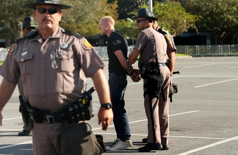 Self-described white nationalist Tyler Tenbrink, of Houston, Texas, is handcuffed by Florida Highway Patrol troopers at the University of Florida (AFP Photo/Brian Blanco)