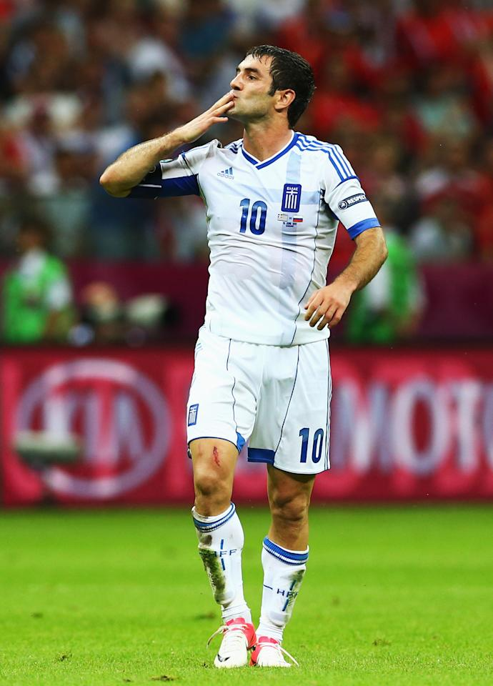 WARSAW, POLAND - JUNE 16:  Giorgos Karagounis of Greece celebrates scoring the opening goal during the UEFA EURO 2012 group A match between Greece and Russia at The National Stadium on June 16, 2012 in Warsaw, Poland.  (Photo by Shaun Botterill/Getty Images)