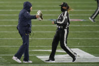 New England Patriots head coach Bill Belichick, left, appeals to down judge Sarah Thomas in the second half of an NFL football game against the Baltimore Ravens, Sunday, Nov. 15, 2020, in Foxborough, Mass. (AP Photo/Elise Amendola)