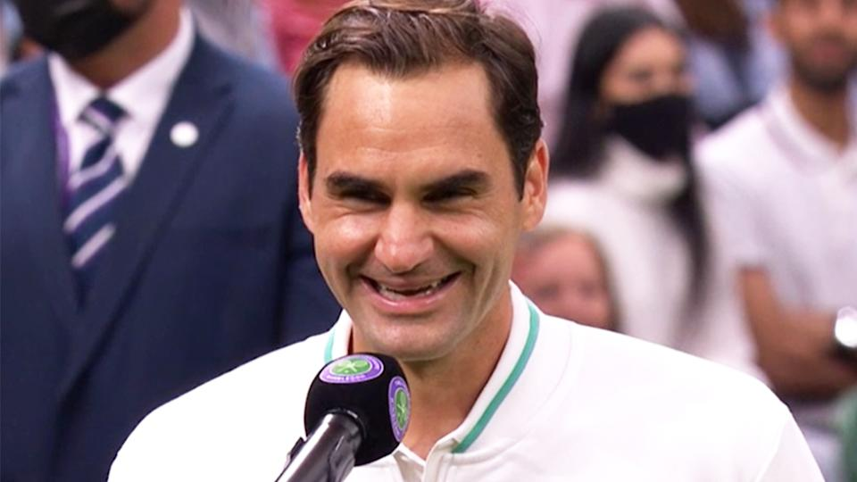 Roger Federer (pictured) laughs during an interview at Wimbledon.