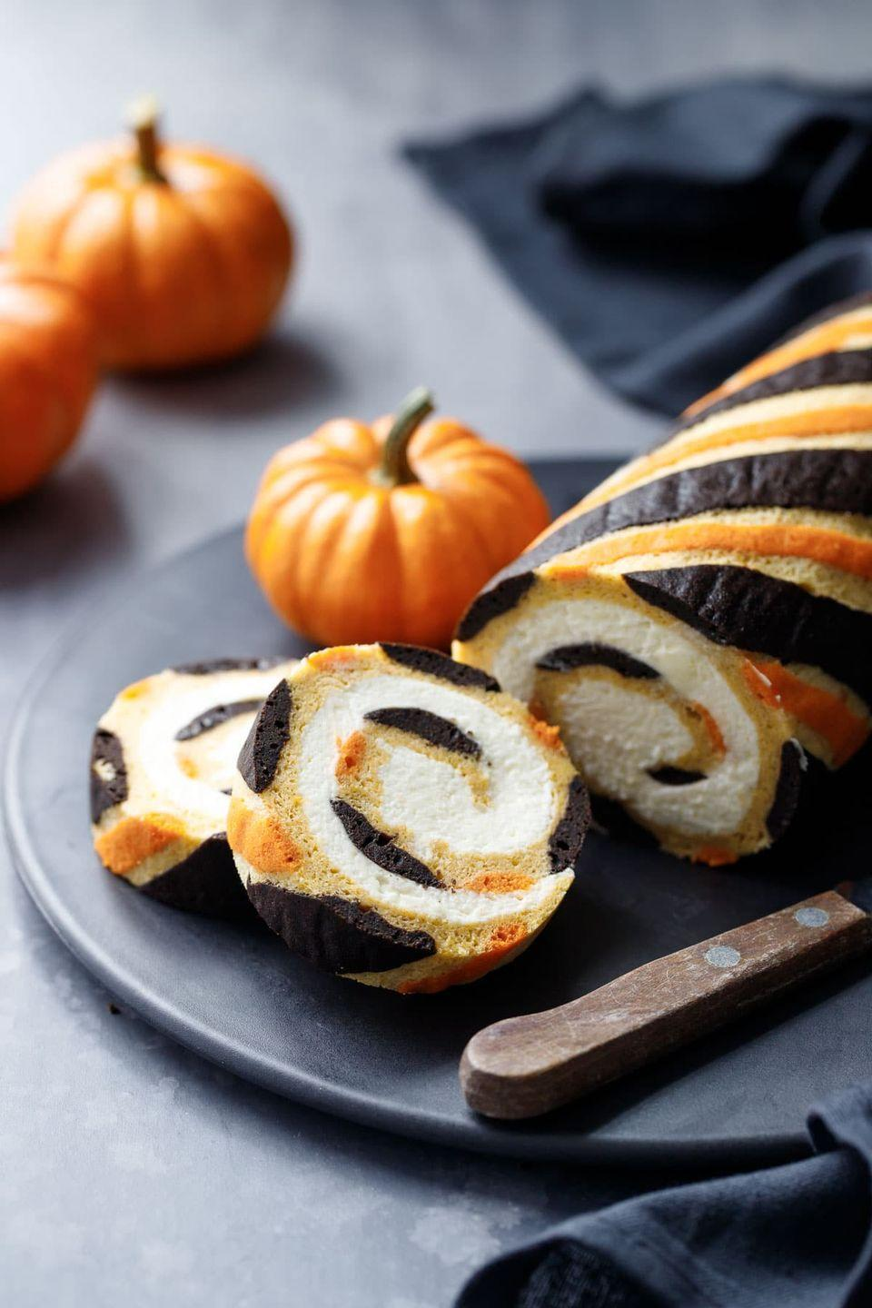 """<p>Upgrade the ubiquitous pumpkin roll with a creamy mascarpone whipped cream filling and stunning black and orange stripes. </p><p><a class=""""link rapid-noclick-resp"""" href=""""https://www.loveandoliveoil.com/2018/10/pumpkin-cake-roll.html"""" rel=""""nofollow noopener"""" target=""""_blank"""" data-ylk=""""slk:GET THE RECIPE"""">GET THE RECIPE</a></p>"""