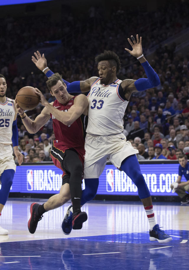 Miami Heat's Goran Dragic, left, of Slovania, drives to the basket against Philadelphia 76ers' Robert Covington, right, during the first half in Game 5 of a first-round NBA basketball playoff series, Tuesday, April 24, 2018, in Philadelphia. (AP Photo/Chris Szagola)